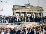 Germans stand on top of Berlin wall